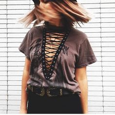 LF vintage Lace up tee✨ • Never Worn only tried on! • Smaller fit (S/M)  • Faded black with brown graphic (looks like bronze)  • Price is pretty firm, offer reasonably. Great fit, not sure if I want to part with it. LF Tops Tees - Short Sleeve