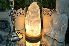 Selenite Crystal Lamp is made with a block of selenite crystal cut and shaped by the skilled artisans. That block is then fixed on a wooden base for stability and décor. A bulb is placed inside the lamp with on/off switch for conve Sala Zen, Feng Shui, Selenite Lamp, Diy Luminaire, Crystal Decor, Crystal Lamps, Meditation Space, Brass Lamp, My Living Room