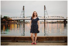 Portland senior photo locations: The dock on the west side of the Willamette River, past waterfront park looking back down toward the Hawthorne Bridge.