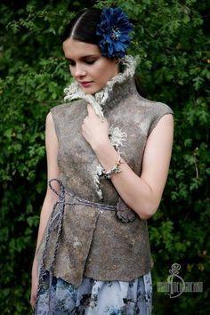 Купить или заказать Валяный жилет «Норвегия» в интернет-магазине на Ярмарке Мастеров. Такая уютная незаменимая вещица в прохладную погоду. Очень теплый, непродуваемый. Сотворен из замечательной новозеланской шерстки. В комплект к жилету есть длинный поясок-шнурок в виде косы с кожаным цветком, чтобы можно было в прохладный ветреный день запахнуться и зафиксировать жилет пояском. Юбочка тоже продается. Сшита специально для данной фотосессии одной милой девушкой Ариной.