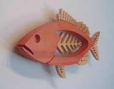 Grouper    Size 29 1/2 wide x 15 1/2 high x 2 1/4 thick. The face stands 3 1/4 from the wall. Artist Statement    Each sculpture is constructed of 3 layers of 3/4 birch plywood. I start by sketching the idea, then creating the design in a computer graphics program. After the pieces are rough cut, the layers are laminated together and shaped to their final contour. The fish was stained with acrylic washes and detailed with acrylic paint. Two layers of a satin acrylic varnish have been…