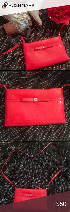 ❤Kate Spade Crossbody❤ Authentic Kate Spade Crossbody. Beautiful bold red color. Like new. This is a reposh, but there is absolutely nothing wrong with this bag. I just need something bigger. Perfect to fit your credit cards, keys, phone and maybe some lipstick and powder. It measures 6X10 inches. kate spade Bags Crossbody Bags