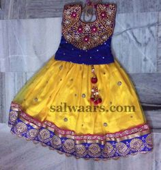 Yellow Lehenga Blue Kundan Blouse