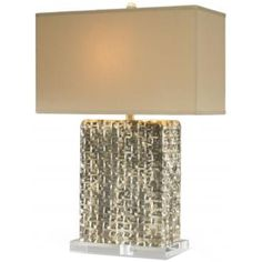 A stunning rectangular lamp with a basket wave pattern and a silver/gold distressed finish on a clean-lined Lucite base.     Finish: Burnt Gold