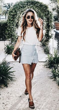 Cute pale blue denim skirt with white tee.