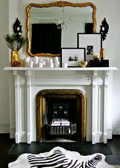 Los ambientes decorados en blanco y negro ofrecen su imagen más chic si se combinan con sutiles toques dorados...