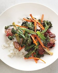 How to Stir Fry by Martha Stewart.... you'll need: 1tbs soy sauce, 2 tsp dry sherry, 2tsp cornstarch, 12oz lean pork shoulder or tenderloin, 2tbs safflower oil, 2 cloves minced garlic, fresh ginger, fresno chile or 1-2 red thai chiles, 8oz broccolini, 2 medium carrots, 4 scallions, coarse salt, 4 cups steamed long grain jasmine rice.