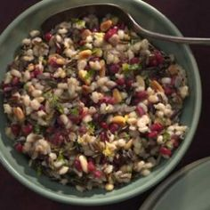 Barley & Wild Rice Pilaf with Pomegranate Seeds Recipe Side Dishes with extra-virgin olive oil, onions, wild rice, pearl barley, reduced sodium chicken broth, pinenuts, pomegranate seeds, grated lemon zest, flat leaf parsley
