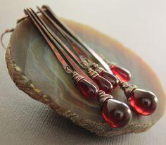 Long sticks chandelier earrings in copper with rich cranberry  red Czech glass teardrops dangles. $32.00, via Etsy.