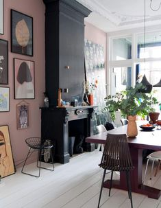 black fireplace with pink walls and art gallery wall. / sfgirlbybay