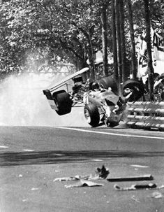 """The 1969 Spanish Grand Prix was the last ever race featuring Formula 1 cars with the """"high-wing"""", the two Lotus cars.Jochen Rindt and Graham Hill. Le Mans, Escuderias F1, F1 Crash, F1 Lotus, Gp Moto, Jochen Rindt, Spanish Grand Prix, Classic Race Cars, Gilles Villeneuve"""