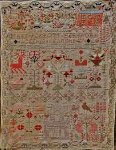 A Victorian child's coloured wool pictorial sampler with place of worship, domestic animals and flowers and having a geometric patterned border, by 'MARY PERROTT....12 YEARS...1847'