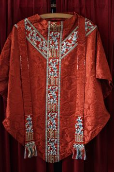 http://www.stelvanschurchaberdare.com/uploads/1/8/9/5/18952999/8491926_orig.jpg Bold and beautiful! Blood red and all that embroidery!