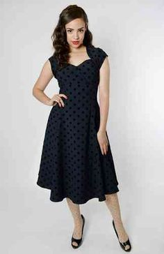 staggering Regina Doll Swing Dress Polka Flock Print Navy - Collectif Clothing by R&B Vintage Clothing in Retroterest. Read more: http://retroterest.com/pin/regina-doll-swing-dress-polka-flock-print-navy-collectif-clothing-2/