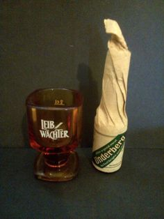 Square stemmed smoky brown Lieb Wachter Bitters glass and Underberg Bitters - http://collectibles.goshoppins.com/barware/square-stemmed-smoky-brown-lieb-wachter-bitters-glass-and-underberg-bitters/