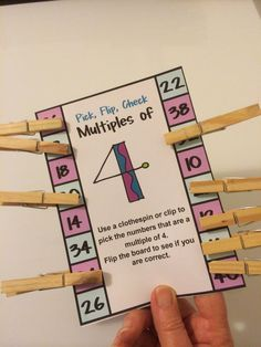 FREEBIES - Multiples and Division Clip, Flip, Check Cards. Children clip the answers with a clothespin. Then they flip the card over to check their answers! The kids love these flip cards!