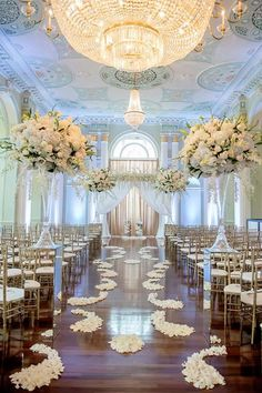 Beautiful ballroom made even more spectacular with ivory florals and mirrored pedestals ~ https://www.insideweddings.com/weddings/white-silver-gold-wedding-at-the-biltmore-ballrooms-in-atlanta/680/