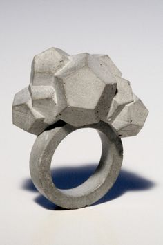 concrete ring - by ?? - link is Studio22 ... (two Taiwan designers)