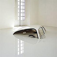 sinking car sculpture - Hasta las Narices by Ivan Pulg
