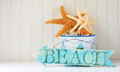I like the look of the starfish piled in a bucked - just not that bucket ;) but a galvanized or white one would be cute