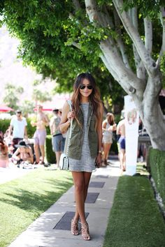 Cargo vest over a neutral mini dress. Love this look!