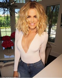 'Throw back pic.... I miss my in shape body put down the fork Khloé'! Khloe Kardashian appeared to be yearning for her summer figure, as she posted a throwback snap from last month on Instagram on Friday