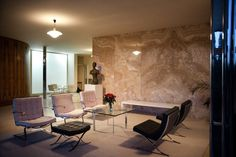 Main living space, group seating in front of the onyx wall in the evening light