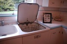 1947 General Electric sink with dishwasher.