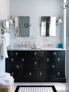 Editor Zim Loy painted a vintage dresser black, added ring pulls for a campaign-chest look, and turned it into a vanity for her Italianate house in Kansas City, Missouri. She also fitted the piece with shallow drop-in sinks, so even the top drawers are usable.