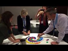 Bottle cap Mosaic Global Ed Forum  2016 - Participants in my Upcycling collaborate on creating mural designs for our local #Keyhole garden made of #ecoladrillos.