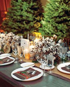 Centerpieces designed by Mindy Rice, featuring cotton balls, pine cones, evergreen sprigs, and flickering candles struck a seasonal tone at this winter wedding in Colorado.