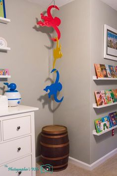 Colorful Disney and Toy Story Inspired Bedroom & Play Room - Project Nursery barrel of monkeys I like the monkeys and the shelving n this room