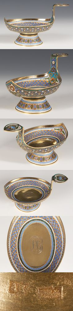 A Russian silver gilt and cloisonne enamel kovsh, Antip Kuzmichev, Moscow, circa 1896-1908 The oval shaped kovsh on a raised cone shape base decorated with scrolling multi-color floral and foliate motifs, interior with an engraved monogram.
