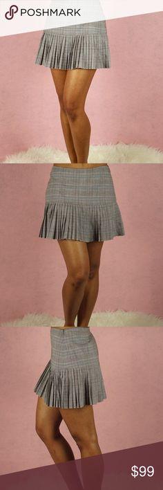 ELIE TAHARI Wool Plaid Pleated Mini Skirt ELIE TAHARI Wool Plaid Micro Pleated Mini Skirt   Size 6 56% viscose 40% virgin wool 4% elastane  Micro pleats Side zipper closure   Waist: 15 1/2 inches  Length: 14 inches Elie Tahari Skirts Mini