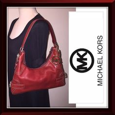 "MICHAEL KORS Red Pebbled Leather Hobo Shoulder Bag MICHAEL KORS DISTRESSED PEBBLED LEATHER HOBO SHOULDER BAG! Features: 100% authentic, buckled style, leather strap, MIchael Kors silvertone buckle hardware, MK gold fob, natural red pebbled leather, leather strap, small hobo design, top zip closure with leather pull & beige cotton lining. Ret:$225. Measures: 11"" across (top), 13"" across (bottom) x 10"" high (side), 7"" high (middle) x 1 1/2"" wide. Minor marks on lining, exterior & light wear on…"