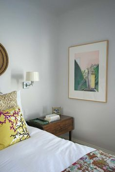Lisa's Colorful, Art-Filled Home. A light and bright bedroom with vintage furniture and good affordable art finds.