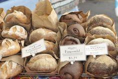 West Seattle Farmers Market Bread bagged up in paper sacks