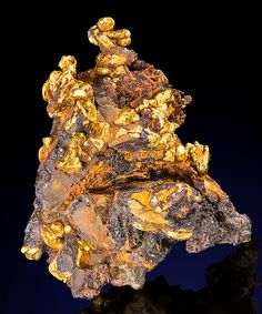 VERY RARE!! Brilliant crystals of Native Gold on orangish-brown Limonite covered Quartz!  From Antioquia Department, Republic of Colombia.  mw