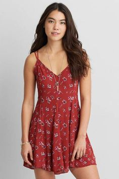 AEO Cross-Back Flowy Dress  by AEO   Take your look from day to night. This dress features pretty, strappy details and a free-spirited print.  Shop the AEO Cross-Back Flowy Dress  and check out more at AE.com.