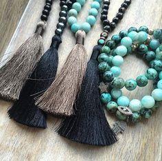 "Gorgeous 8mm wood beads and a silky luxe tassel make up this gorgeous, wear everywhere necklace. Hangs approx. 35"". Tassel is approx. 3.5"". Signature tag. Listing is for one necklace. Shown far left in group photo. Shown with diamonds in second photo. This necklace would be without diamonds.Please note that all items are handmade by me, start to finish, I design, create, market, and pack and ship each piece myself. I love what I do. Some items are available to ship..."