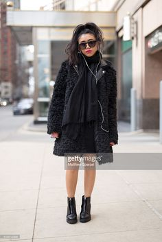 Chloe Maguigad is seen on Michigan Avenue wearing Forever 21 black coat and glasses, H&M black leather jacket and boots, Gap black turtleneck, black PacSun skirt, milk carton Skinnydip London x Topshop bag, and black BCBG scarf on February 7, 2016 in Chicago, Illinois. Photo by Matthew Sperzel/Getty Images.