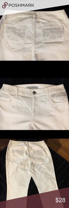 Chico's Platinum Denim Size 0.5 White with lots of silver accents. I wore these one time and just didn't have the figure to fill them out. They would look awesome on someone that wears a size 8/10. Chico's Jeans Straight Leg