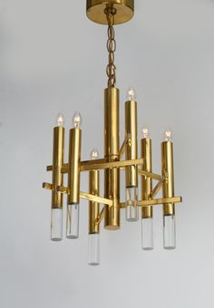Constructivist Brass and Lucite Pendant by Gaetano Sciolari | From a unique collection of antique and modern chandeliers and pendants  at https://www.1stdibs.com/furniture/lighting/chandeliers-pendant-lights/