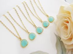 Sea foam glass drop w/ matte gold trim necklace // Etsy, $130 per set of 7