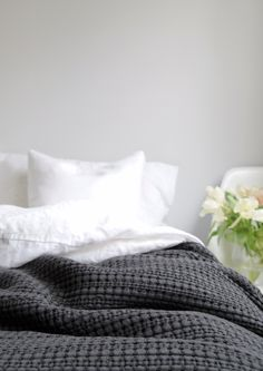 Home is better with U, with Urbanara - charcoal cotton quilt bedspread in a light grey bedroom photo by Hege in France