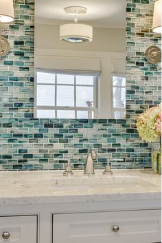 Bathroom wall accent. The wall tile is from Complete Tile Collection - Zumi Glass Tile. Bathroom with marble countertop and wall accent…