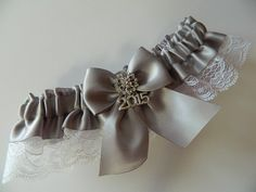 An elegant prom garter silver satin white Rachel Lace This prom garter is embellished with a bow rhinestone and 2015 charm .  ~~~ ~~My wedding garter are made-to-order and comfortably stretch from 12