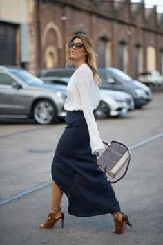 Navy skirt, white blouse, brown suede & leather heels.