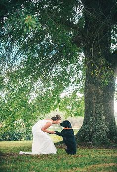 Bride with Black Lab Ways to Include Your Pet in the Wedding | http://Brides.com