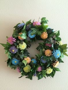 Handcrafted pinecone zinnia wreath created on grapevine wreath with zinnias handcrafted from freshly harvested pinecones. The pinecones were
